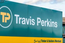 Travis Perkins profits plunge